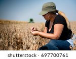 young farmer girl examing...   Shutterstock . vector #697700761