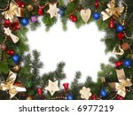Christmas framework made of fir branches and various decorations with white copy space - stock photo