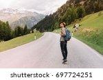 young man in trendy hat... | Shutterstock . vector #697724251