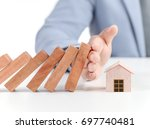businessman covering home with... | Shutterstock . vector #697740481
