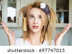 young girl trying to comb her... | Shutterstock . vector #697747015