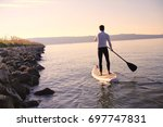 Man On A Sup Stand Up Paddle...