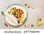 vegetarian taco wraps....   Shutterstock . vector #697748449