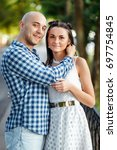 a loving couple on a walk down... | Shutterstock . vector #697754845
