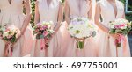 bride and bridesmaids hold... | Shutterstock . vector #697755001