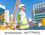 engineer man in helmet and... | Shutterstock . vector #697779931