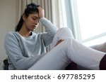 tired young woman sitting on... | Shutterstock . vector #697785295