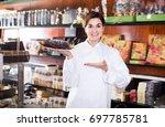 happy female seller offering... | Shutterstock . vector #697785781