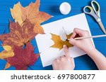 making ghosts from maple leaves ... | Shutterstock . vector #697800877