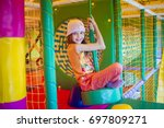 cute little girl is playing on... | Shutterstock . vector #697809271