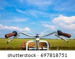 bicycle  field and blue sky... | Shutterstock . vector #697818751