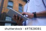 browsing online on tablet ...   Shutterstock . vector #697828081