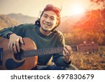 asian man toothy smiling face... | Shutterstock . vector #697830679