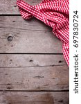 red and white kitchen towel on... | Shutterstock . vector #697830724
