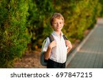 smiling schoolboy with school...   Shutterstock . vector #697847215