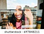 beautiful indian woman looking... | Shutterstock . vector #697848211