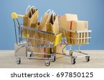 paper shopping bags and paper... | Shutterstock . vector #697850125
