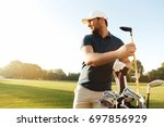 focused young man golfer taking ... | Shutterstock . vector #697856929