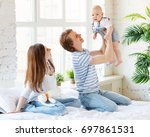 happy family mother father and... | Shutterstock . vector #697861531