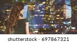 back view of woman looking at... | Shutterstock . vector #697867321