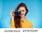 beautiful woman with camera in... | Shutterstock . vector #697870339