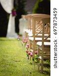 wedding set up in a garden.... | Shutterstock . vector #697873459