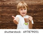 the kid drinking cocoa at home... | Shutterstock . vector #697879051