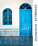 greek islands door. traditional ... | Shutterstock . vector #697885615