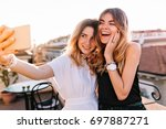 portrait of laughing friends... | Shutterstock . vector #697887271