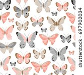Stock vector vector seamless pattern with butterflies 697902034