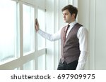 a man in a beautiful suit and... | Shutterstock . vector #697909975