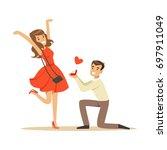 happy man proposing marriage to ... | Shutterstock .eps vector #697911049