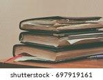 heap of old notebooks | Shutterstock . vector #697919161