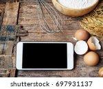 smart phone with baking flour... | Shutterstock . vector #697931137