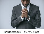 partial view of focused african ... | Shutterstock . vector #697934125