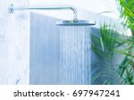 outdoor rain shower in the... | Shutterstock . vector #697947241
