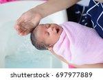 mother give a bath her newborn... | Shutterstock . vector #697977889