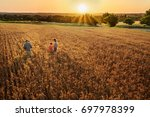 top view. a farmer  his wife... | Shutterstock . vector #697978399