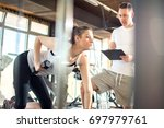 sporty young woman lifting... | Shutterstock . vector #697979761