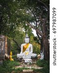 an ancient buddha surround by... | Shutterstock . vector #697987099