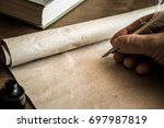 hand writing with old quill pen ... | Shutterstock . vector #697987819