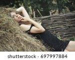 girl lying on a haystack | Shutterstock . vector #697997884