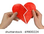 male and female holding broken heart. Isolated on white - stock photo