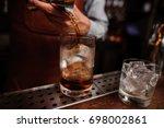close up shot of barman hand... | Shutterstock . vector #698002861