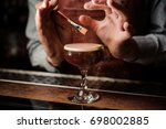 the barman decorates the... | Shutterstock . vector #698002885