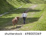 the man in the hat is leading... | Shutterstock . vector #698005369