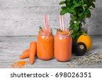 Bright Orange Smoothies In Hug...
