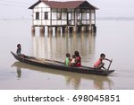 Small photo of 16th August 2017 in Marigaon, Assam, India. Kids on a boat in a flood affected area.