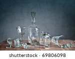 Still Life with differently shaped glass bottles - stock photo