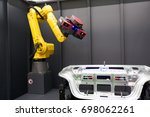 Small photo of Robot arm with 3D scanner. Automated scanning.